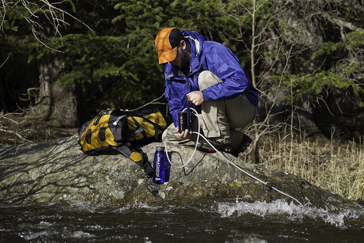 best backpacking water filter in use at the river