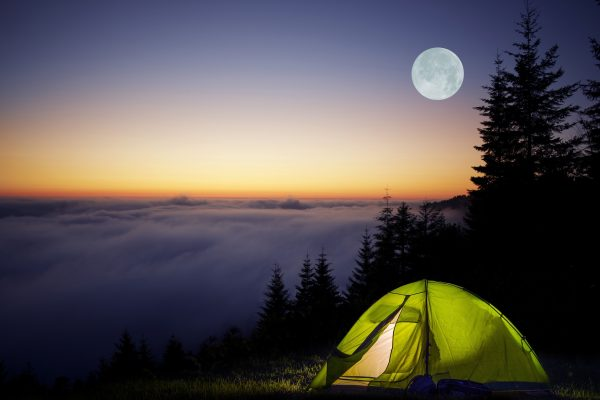 Tent Camping in a Forest During Full Moon Night. Foggy Mountains Camping.