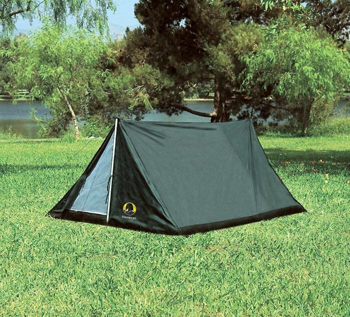 An A Frame tent setup beside the lake