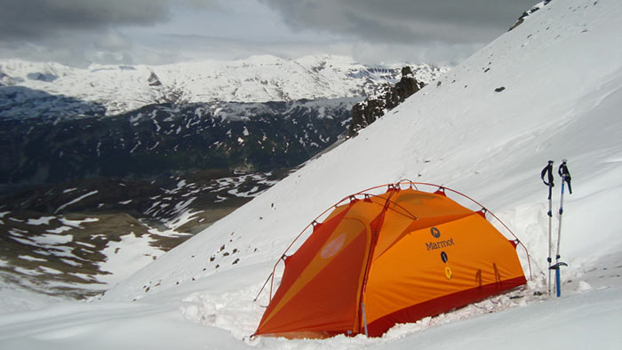 Marmot winter tent on a snow capped hillside