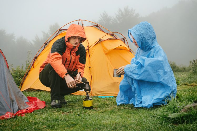 Making coffe while tent camping in the rain