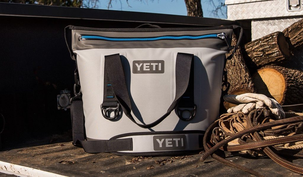 Yeti Hopper soft sided cooler on a wooden deck