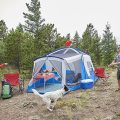 Family in a Wenzel Klondike camping tent with screened porch