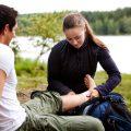 Injured camper having a bandaid applied