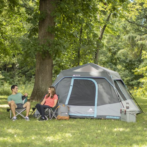 Young campers sat outside the Ozark Trail 6 Person Darkrest Tent